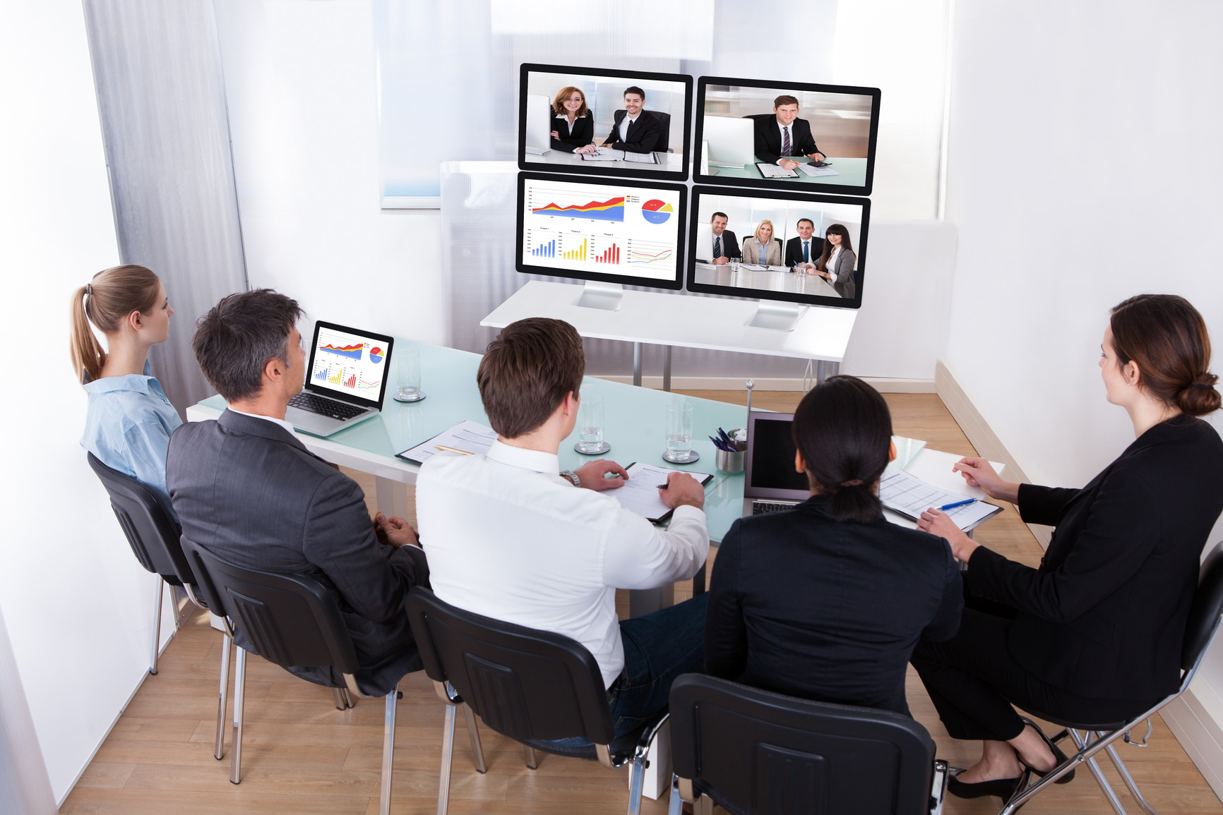 High Angle View Of Businesspeople In Video Conference At Business Meeting