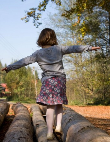 vestibular girl on log